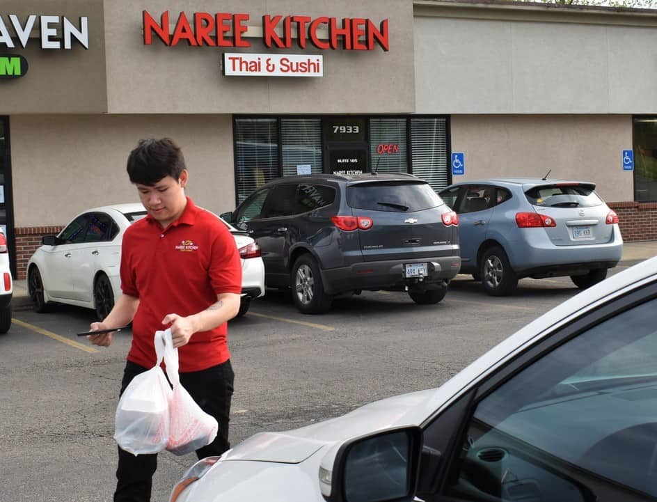 Our server delivering our order curbside at Naree kitchen in Kansas City, Kansas.