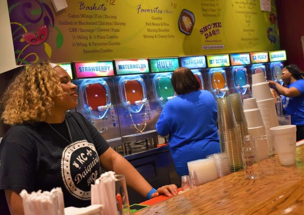 Colorful mixes are doled out to eager customers at KC Daiquiri Shop.