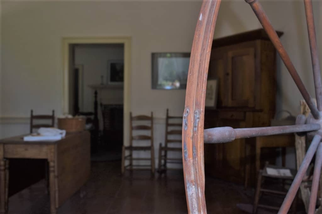 A spinnng wheel sits silent in the historic home of George Caleb Bingham.