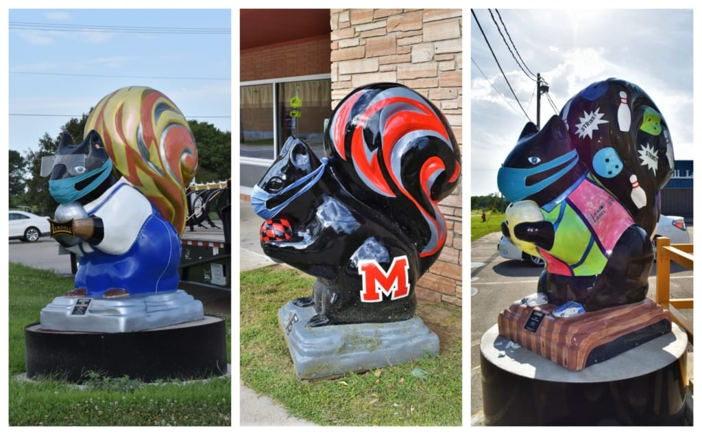 Three of the colorful black squirrel statues that can be found scattered around Marysville.