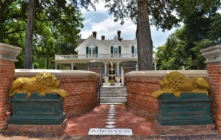 The entrance to the Koester House Museum is guarded by statues purchased at the worlds fair.