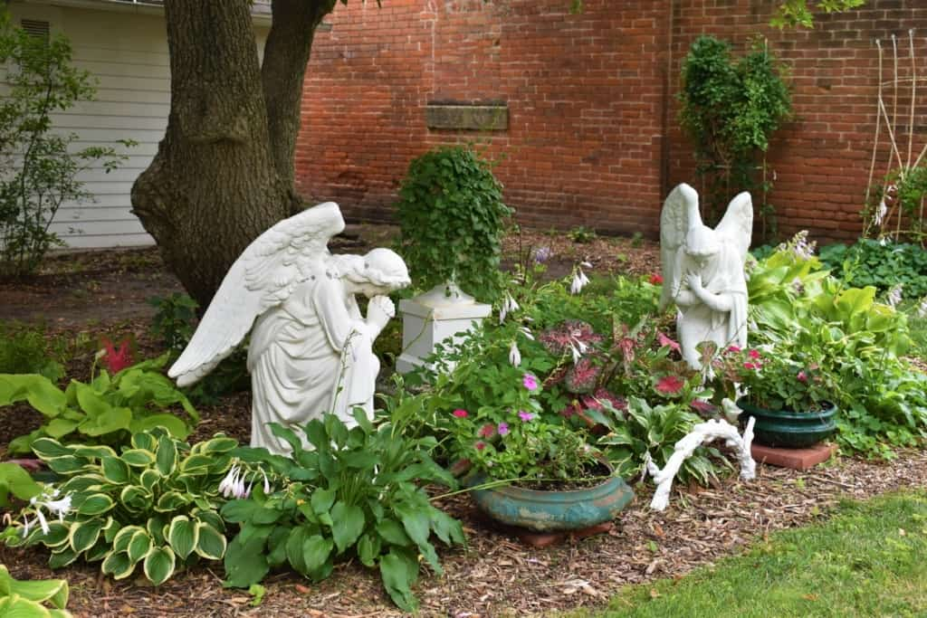 Winged angels stand guard in the gardens at the Koester House.