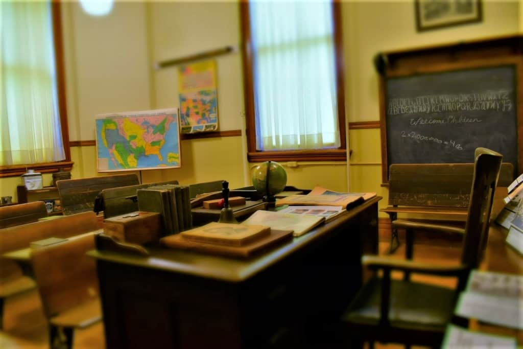 An old school room reminds us of the history that lies behind the growth of every city and town.