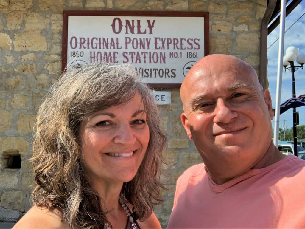 The authors pause for a selfie outside the Pony Express Barn Museum.