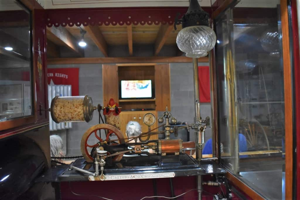 An old-fashioned popcorn maker frames the short film explaining the purpose of the Pony Express Barn Museum.