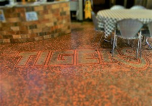 The coin embedded floor at Tiger Burgers had us looking for iconic phrases.
