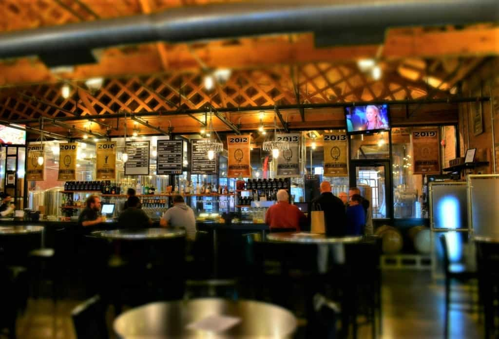 The locals hang out at the bar and celebrate the many awards the brewery has received.