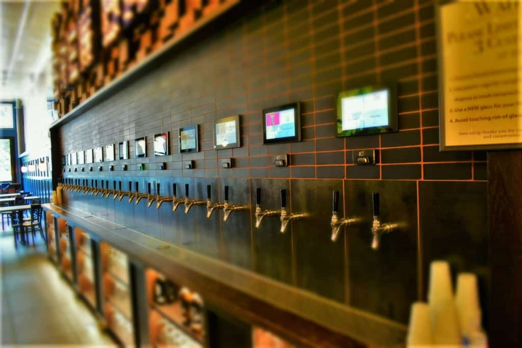 A row of taps allows customers to sample the beers by doing some self-serve banking.