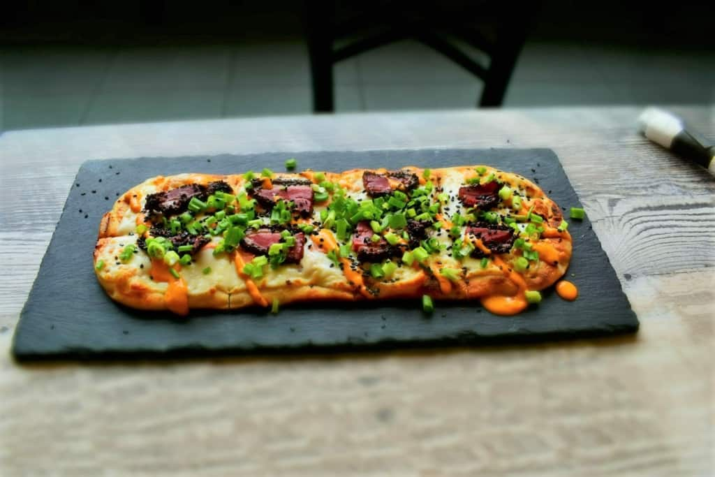 The Brew Bread is the Brew bank's version of a flatbread pizza, but with international flair.