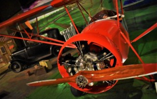 A pilot prepares to take to the skies in his airplane manufactured by the Nicholas-Beazley Airplane Company.