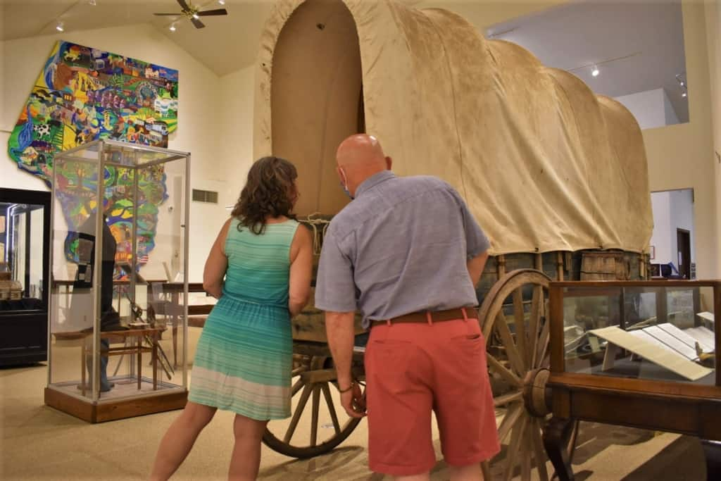 The authors explore an old wagon on display at Boone County History Museum.