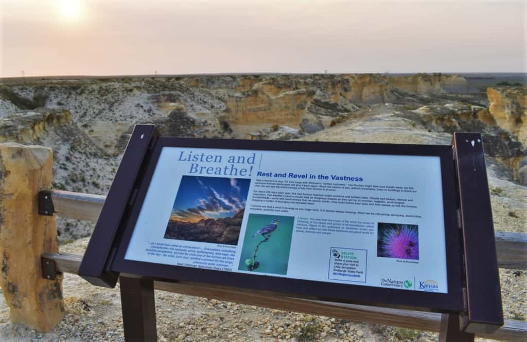 This sign reminds visitors to pause and take in the whole experience of the Kansas Badlands.