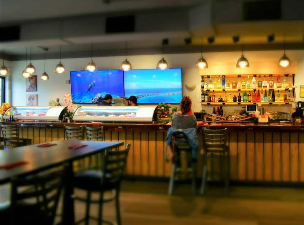 The interior at Sushi Karma offers casual clean lines that welcome diners.