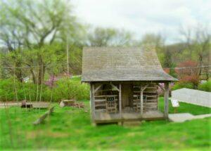 The Didier Log Cabin greets visitors to Brownville, Nebraska.
