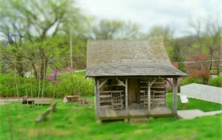 The Didier Log Cabin greets visitors to Brownville, Nebraska.