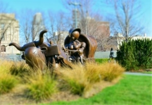 The large wagon sits at the entrance to the Joslyn Art Museum.