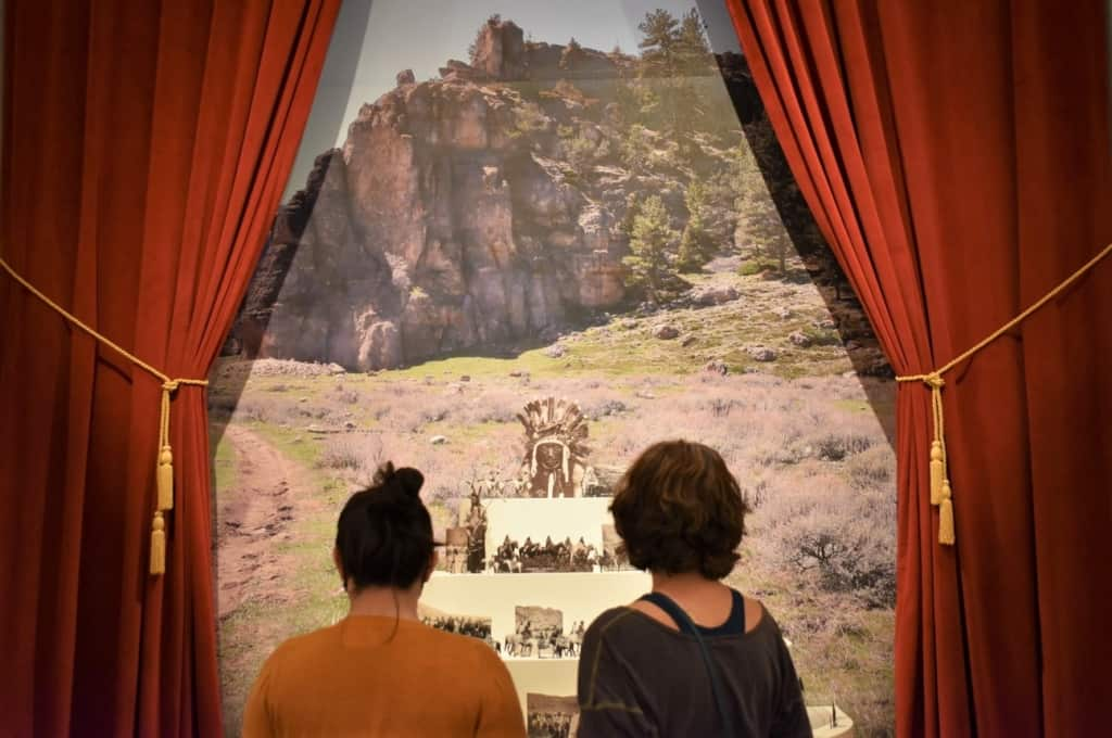 crystal and Amanda take in the details of the traveling exhibit.