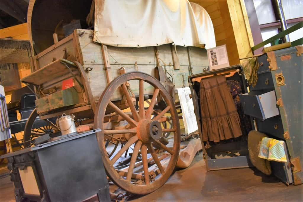 Pioneers traveled westward in covered wagons to reach the Nebraska frontier.