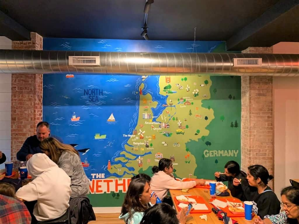 The interior mural helps showcase the country of the Netherlands.