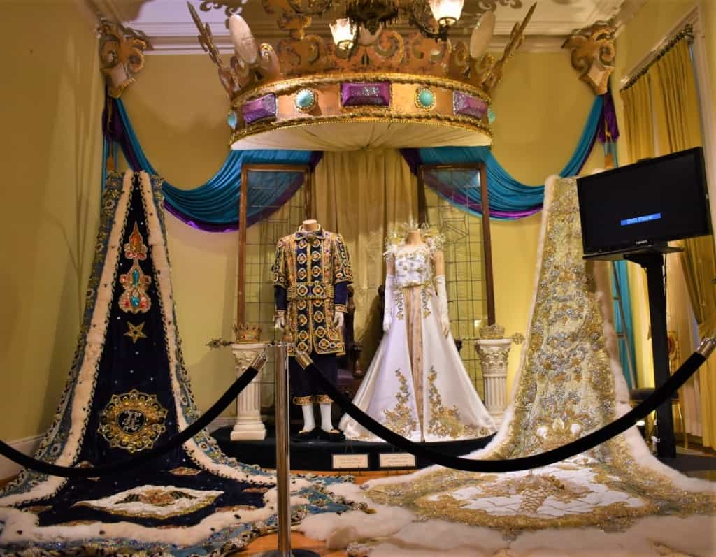 The regalia of the formal balls is represented in some of the galleries.