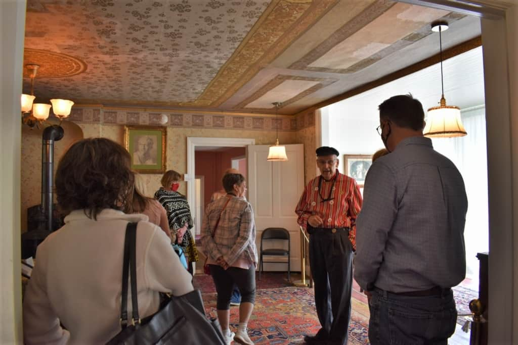 A native guide tells visitors about the life of the family who lived in the Scholte House Museum.
