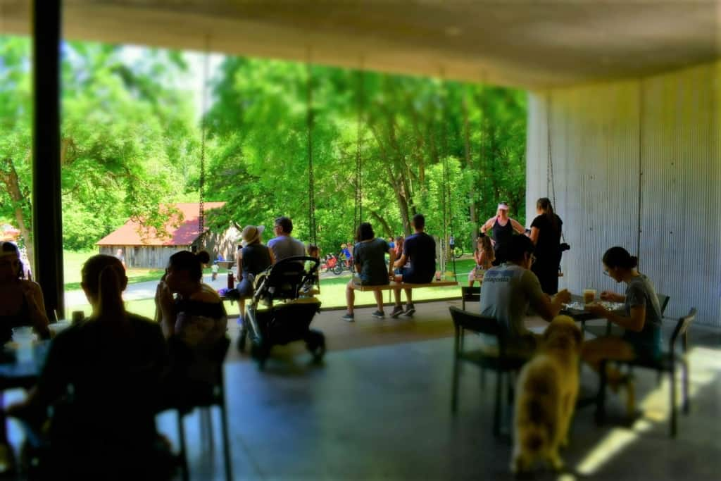 Walkers and bikers alike enjoy the nature break afforded them during a stop at Airship Coffee.