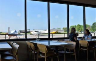 Watching the planes take off adds airborne inspiration to a morning meal.