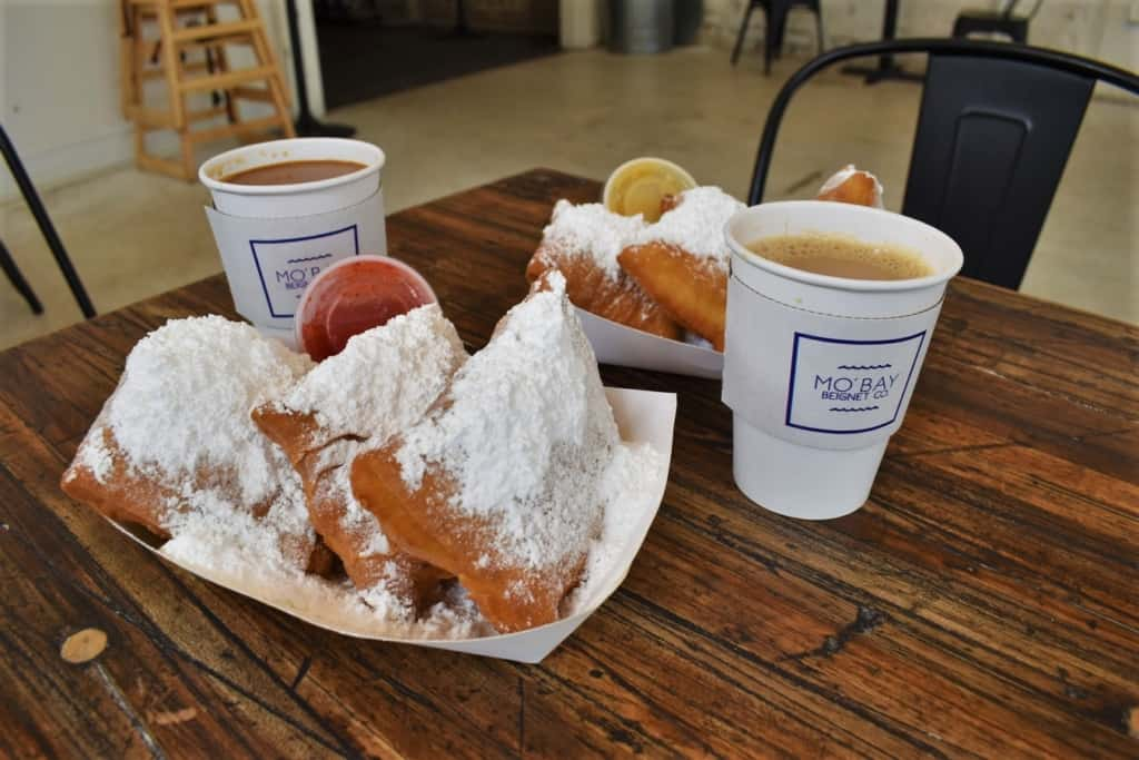 The powder sugar coated beignets are the perfect compliment to fresh cups of cafe au lait.