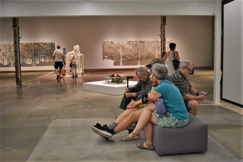 Visitors take a break from the summer heat to enjoy the artwork on display at The Momentary in Bentonville, Arkansas.
