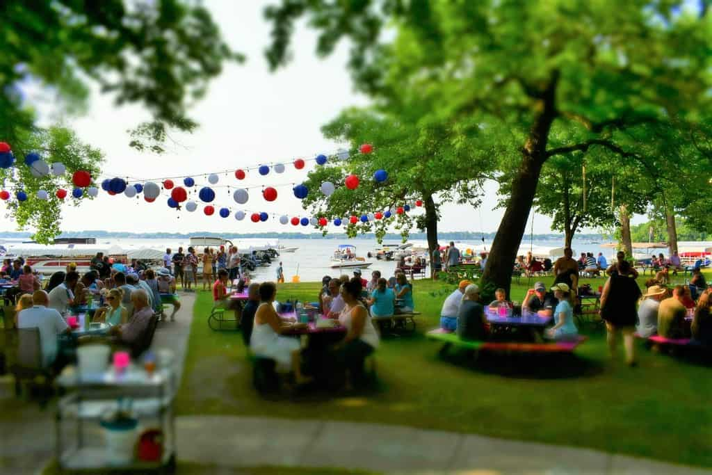 A crowd gathers at Clear Lake to celebrate the holiday with a patriotic twist.