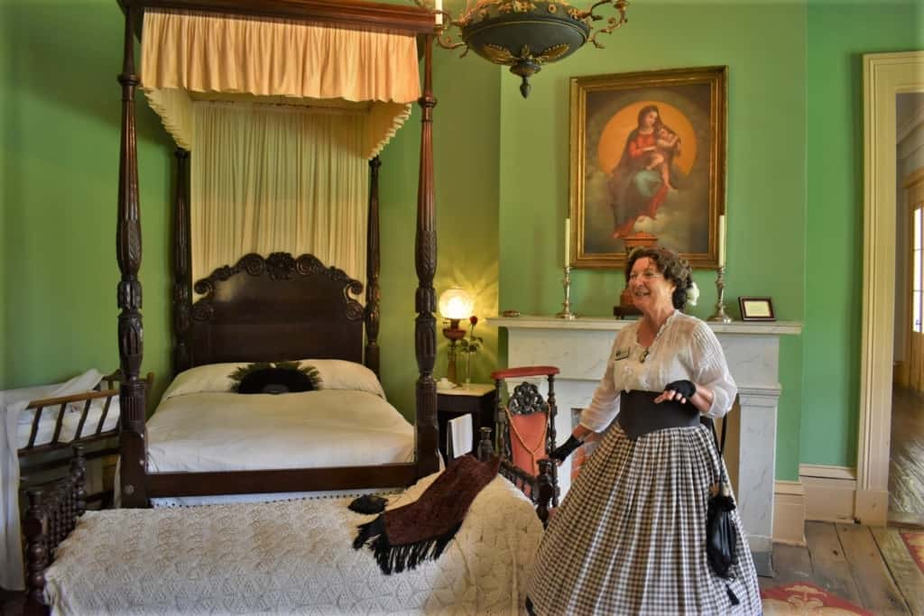 Our tour guide shows off the luxury afforded to the family who inhabited Destrahan Plantation.