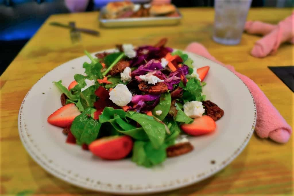 One of their fresh salads is delivered with artistic cuisine in mind.